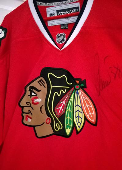 2010 Stanley cup winner CHRISTOBAL HUET (Blackhawks Goalie) signed jersey.