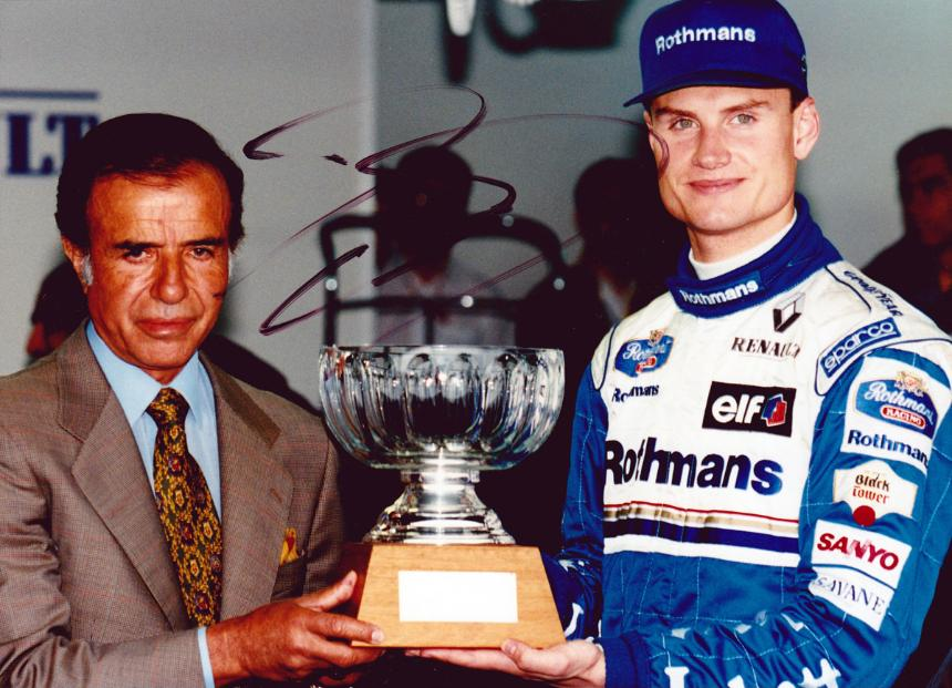David Coulthard signed photo of him receiving pole Position Trophy at Argentinian Grand Prix.