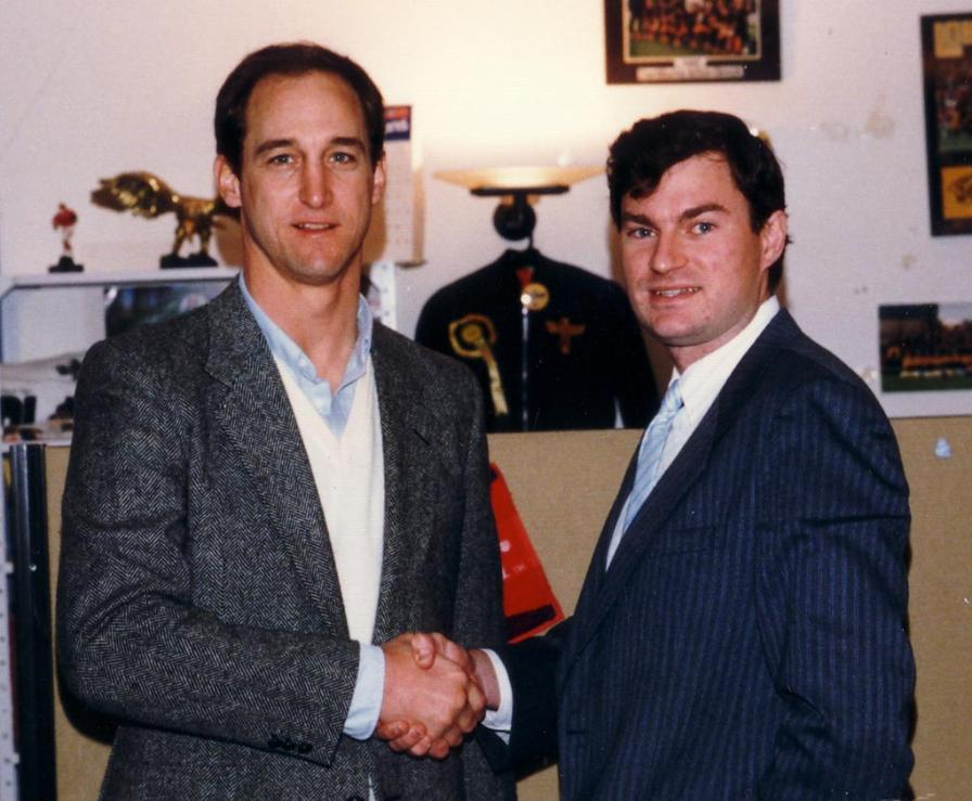 Colin Jarman and Steve Grogan (Patriots) in Budweiser League officee